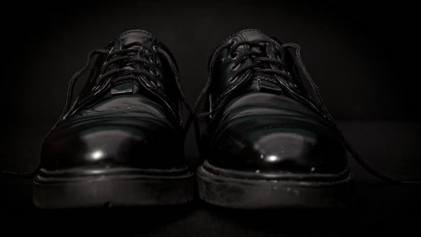 Front view of a black wingtip shoe