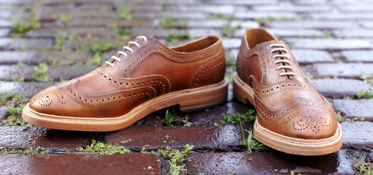 Brown leather shoes on brick ground