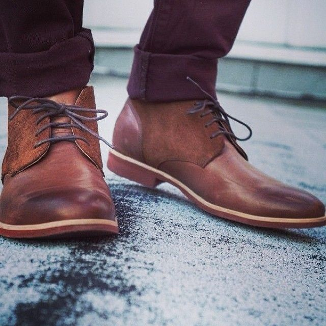 Brown wingtip shoes on concrete ground