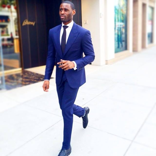 Men walking in blue suit and blue dress shoes