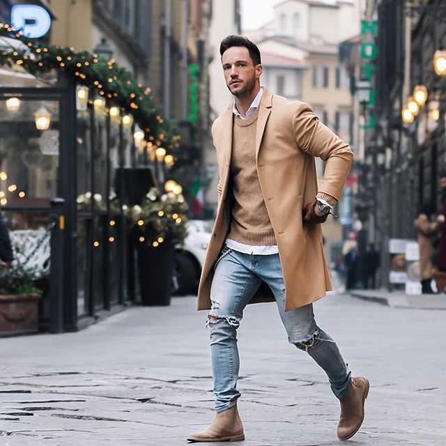 Men walking around city in a brown coat and boots